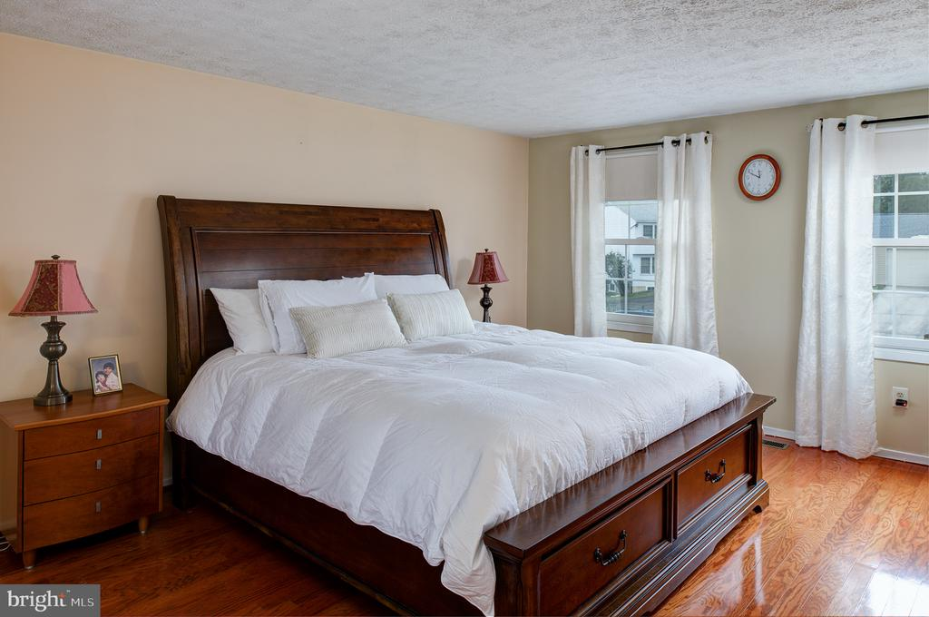 Master bedroom with king sized bed - 3295 BLUE HERON DR, FALLS CHURCH