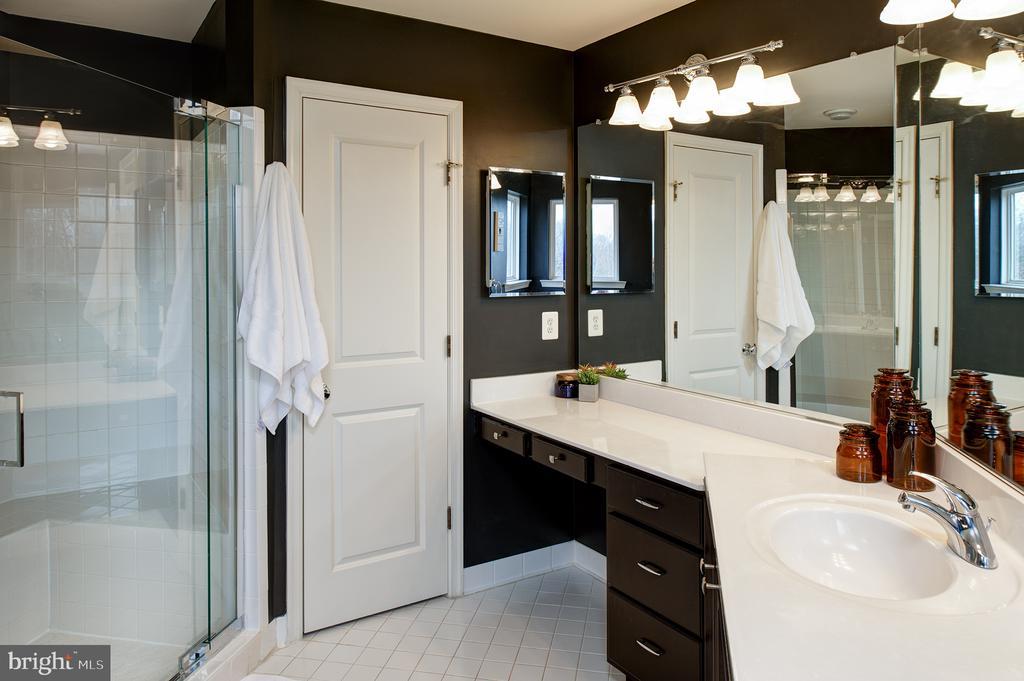 Master bath with frameless shower & double vanity - 6717 ECKERT CT, WARRENTON