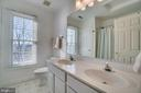 Hallway bathroom with double sinks - 42922 PALLISER CT, LEESBURG