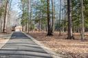 Private driveway with gravel pull off areas - 5916 HALLOWING DR, LORTON