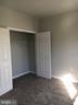 Bedroom #2 closet with double doors - 22655 BLUE ELDER TER #303, BRAMBLETON