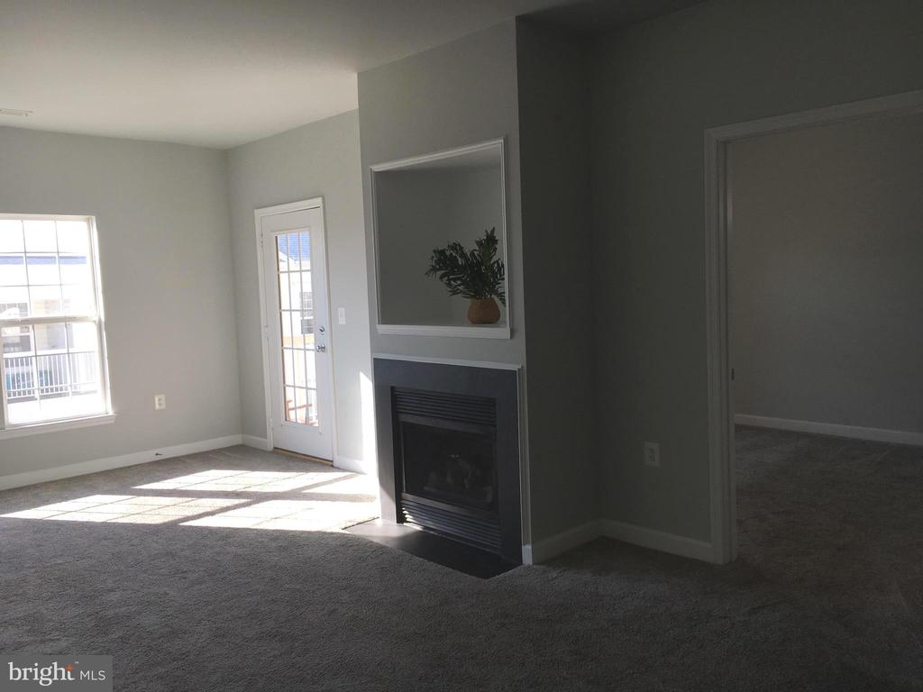 Family Room with fireplace, access to deck - 22655 BLUE ELDER TER #303, BRAMBLETON
