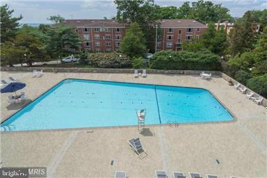 Take a dip.....or enjoy the sun! - 1200 N NASH ST #551, ARLINGTON