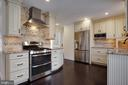 Awesome accented backsplash & new cabinets abound! - 549 DRUID HILL RD NE, VIENNA