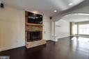 A gas fireplace and mounted TV for any gathering - 549 DRUID HILL RD NE, VIENNA