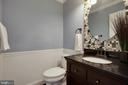 Half bath is so lovely with new vanity  & mirror - 549 DRUID HILL RD NE, VIENNA