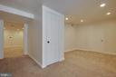 Lower level bedroom with closet & recessed lights - 549 DRUID HILL RD NE, VIENNA