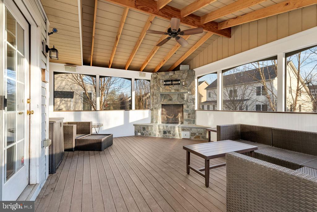 Recently added enclosed porch with fireplace - 42445 MEADOW SAGE DR, BRAMBLETON