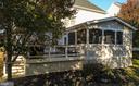 Enclosed porch and rear deck - 42445 MEADOW SAGE DR, BRAMBLETON