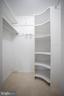 Master Bedroom Walk-In Closet with custom shelves - 7126 BRIDGEPORT CT, SPRINGFIELD