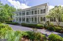 Double front porches and majestic white pillars - 12970 WYCKLAND DR, CLIFTON