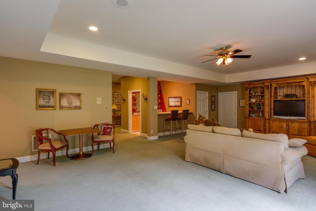 Large Rec Room in the lower level with fireplace - 12970 WYCKLAND DR, CLIFTON