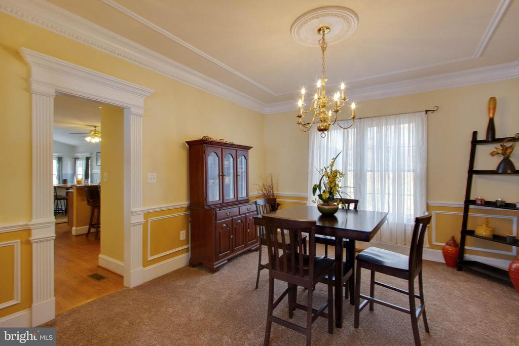 Exquisite craftsmanship in this dining room - 3713 STONEWALL MANOR DR, TRIANGLE