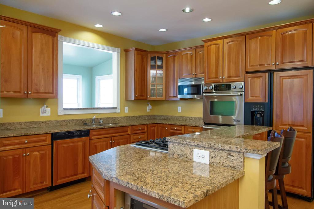 Breakfast bar on island for additional seating - 3713 STONEWALL MANOR DR, TRIANGLE