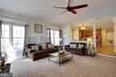 Family room opens to kitchen for easy entertaining - 3713 STONEWALL MANOR DR, TRIANGLE
