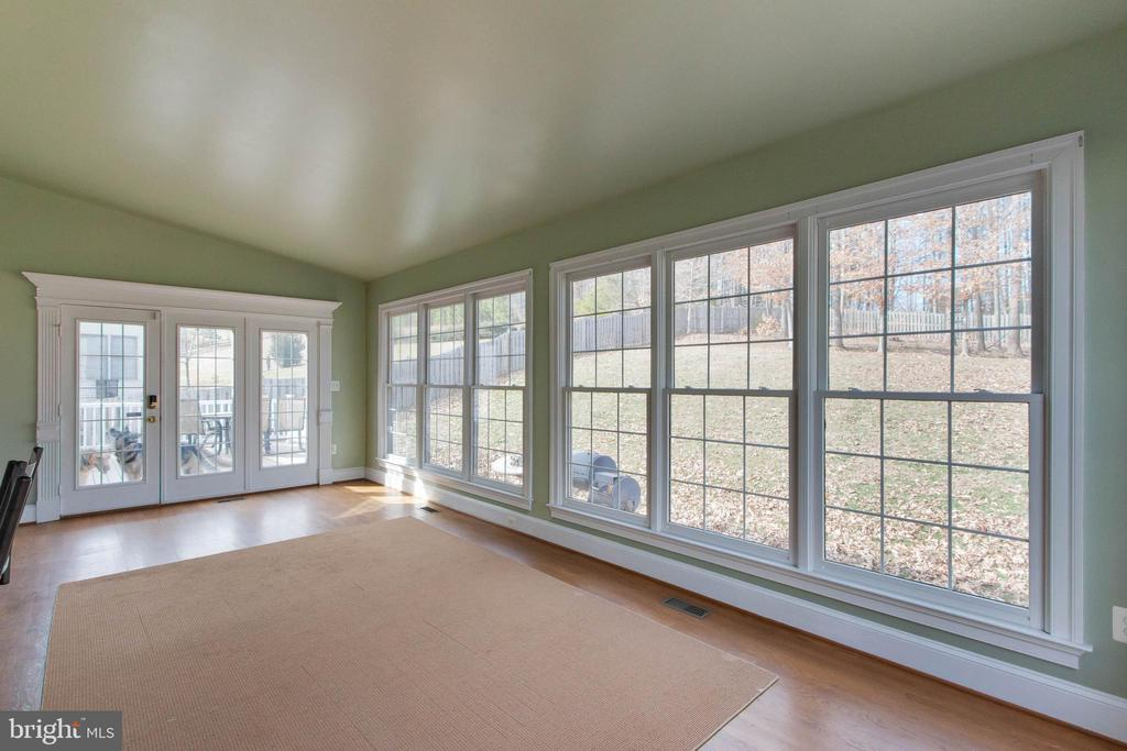 Huge sunroom with wall of windows - 3713 STONEWALL MANOR DR, TRIANGLE