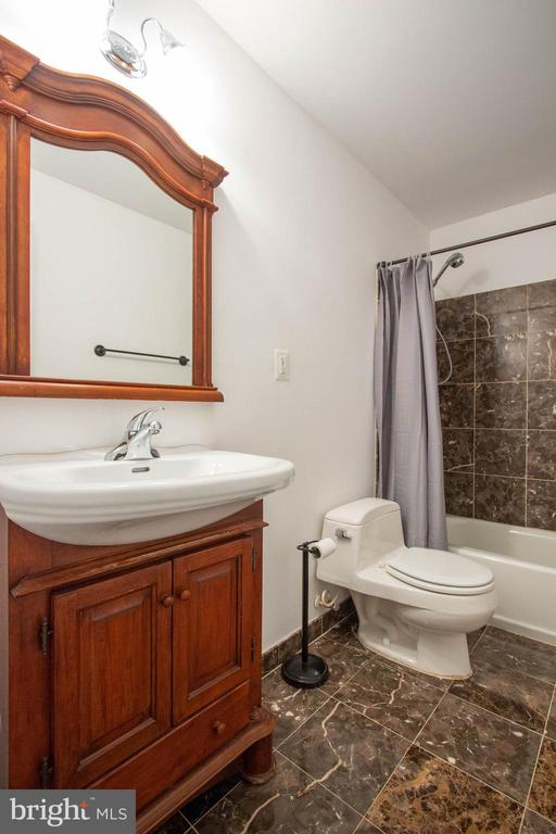 Gorgeous tile in basement full bath - 3713 STONEWALL MANOR DR, TRIANGLE