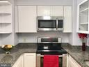Kitchen with Granite Counter Tops - 22 COURTHOUSE SQ #407, ROCKVILLE