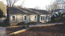 Large concrete patio off kitchen  walk out - 7126 BRIDGEPORT CT, SPRINGFIELD