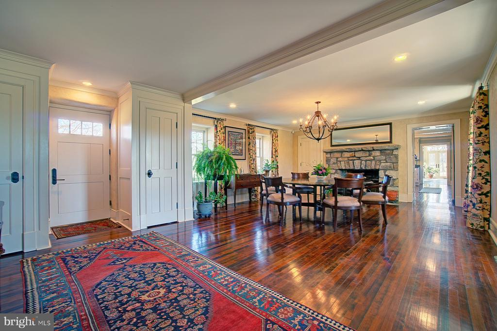 Dining room with stone fireplace - 22941 FOXCROFT RD, MIDDLEBURG