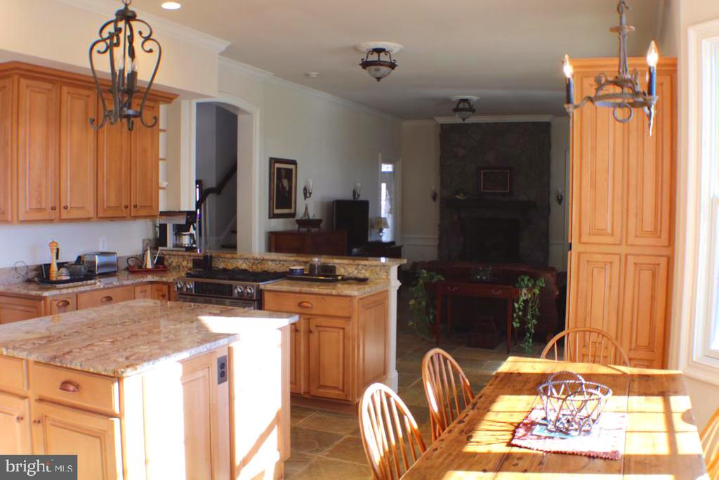 KITCHEN WITH GRANITE COUNTERTOPS AND STONE FLOORS - 20970 STEPTOE HILL RD, MIDDLEBURG