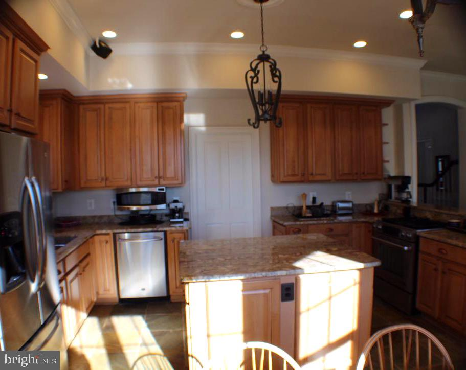 KITCHEN FLOWS IN TO OFFICE THROUGH POCKET DOOR - 20970 STEPTOE HILL RD, MIDDLEBURG