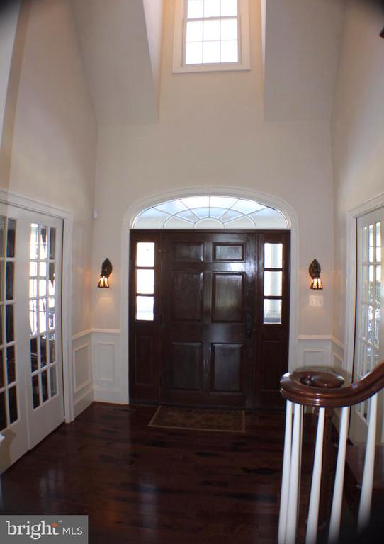 VIEW OF TWO STORY FOYER AND 42 IN SOLID WOOD DOOR - 20970 STEPTOE HILL RD, MIDDLEBURG