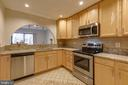 Kitchen with SS appliances and granite - 1039 WARWICK CT, STERLING