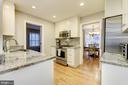 Gleaming kitchen w/ granite counters - 5913 WELBORN DR, BETHESDA