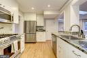 Remodeled kitchen w/ stainless appliances - 5913 WELBORN DR, BETHESDA