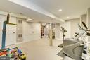Basement game room/gym/guest room - 5913 WELBORN DR, BETHESDA