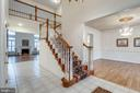 Staircase to the upper level with oriental runner - 18403 KINGSMILL ST, LEESBURG