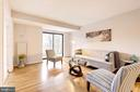 Bright Living Room with access to Balcony. - 2111 WISCONSIN AVE NW #205, WASHINGTON