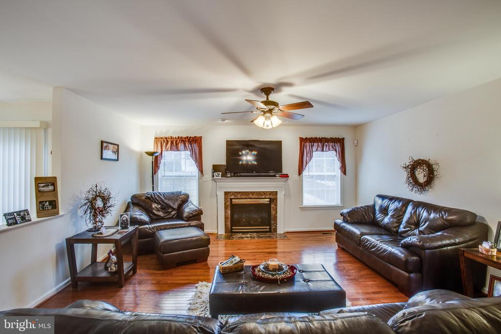 FAMILY ROOM WITH GAS FIREPLACE - 19 SAINT CHARLES CT, STAFFORD