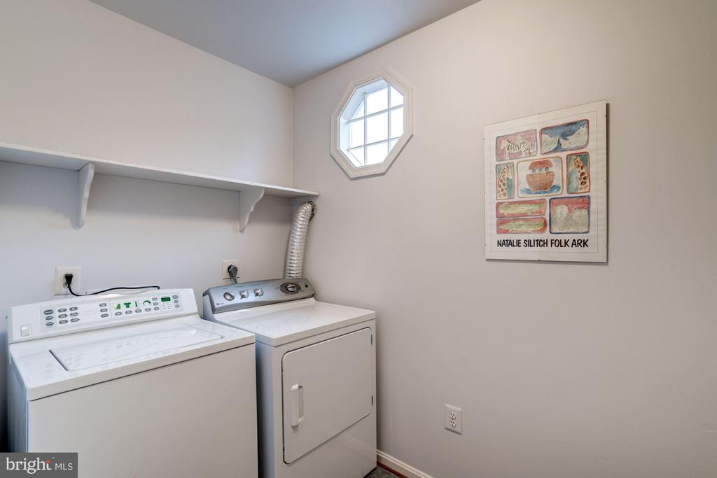 a  full sized laundry room with natural light - 9097 WEXFORD DR, VIENNA