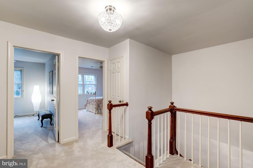 Upstairs, the spacious landing leads to - 9097 WEXFORD DR, VIENNA