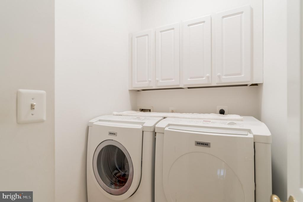 Upper level front loading washer and dryer - 9100 BRIARWOOD FARMS CT, FAIRFAX