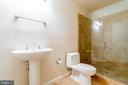 Renovated full bath in the lower level - 9100 BRIARWOOD FARMS CT, FAIRFAX