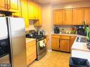 Kitchen with stainless steel appliances - 501 BOWERS LN, HERNDON