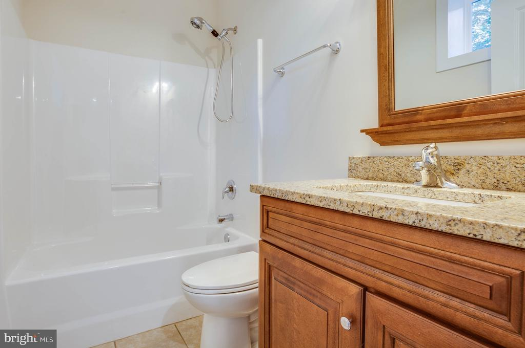 LOWER LEVEL FULL BATH OF PREVIOUSLY BUILT HOME - 105 EDGEMONT CIR, LOCUST GROVE