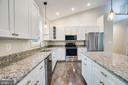 KITCHEN OF PREVIOUSLY BUILT HOME - 105 EDGEMONT CIR, LOCUST GROVE