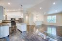 OPEN KITCHEN/LIVING ROOM OF PRIOR BUILT HOME - 105 EDGEMONT CIR, LOCUST GROVE