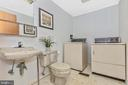 Main floor powder/laundry room right off kitchen - 110 ELK DR, HANOVER