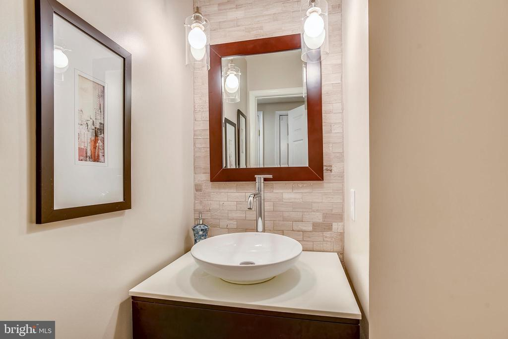 Powder room w/tile accent wall & pendant lights - 20702 MANDALAY CT, ASHBURN
