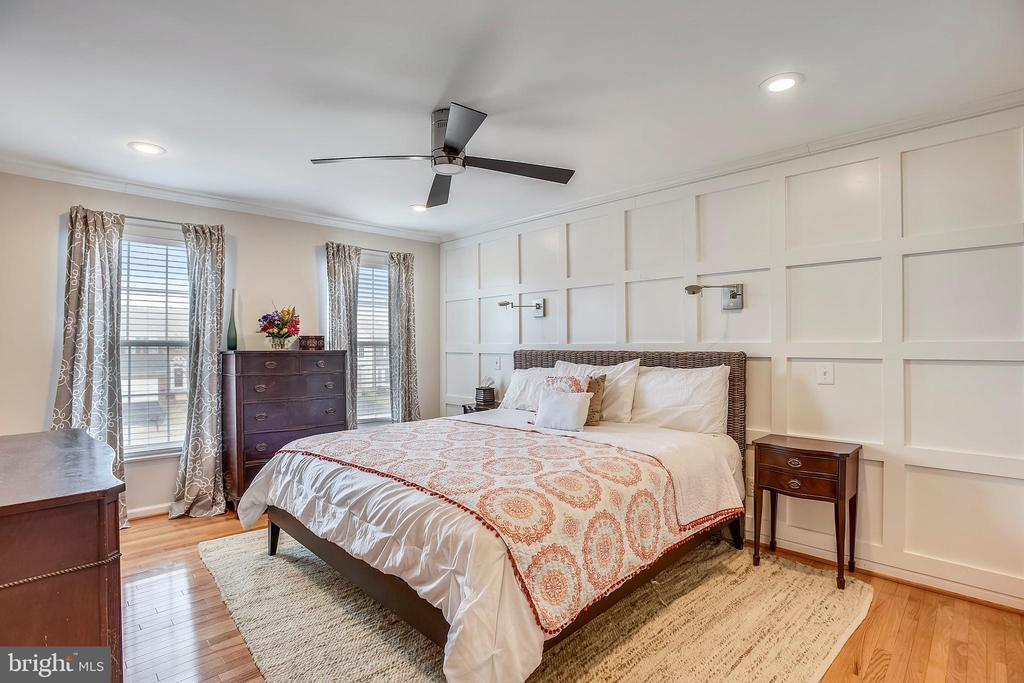 Master bedroom with white wood accent wall! - 20702 MANDALAY CT, ASHBURN