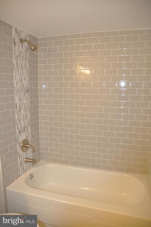 New tile in bathrooms - 125 N-N CLUBHOUSE DR SW #2, LEESBURG