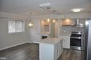 Granite and hardwood floors - 125 N-N CLUBHOUSE DR SW #2, LEESBURG