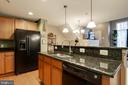 Open kitchen with pantry - 6260 WOODRUFF SPRINGS WAY #23, HAYMARKET