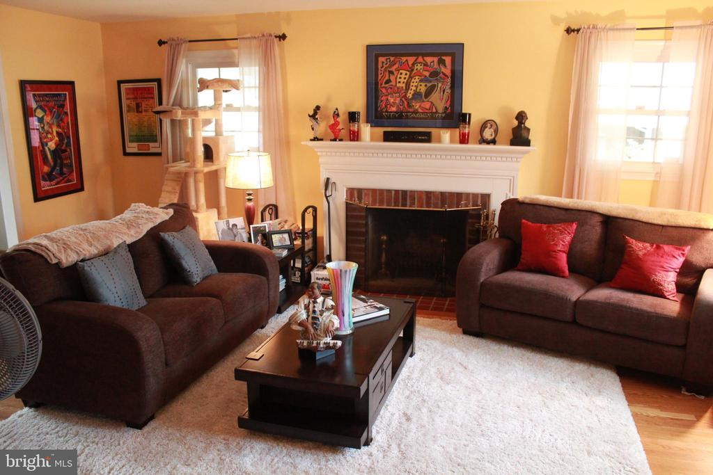 Living room showing wood burning fireplace - 9005 CHERRYTREE DR, ALEXANDRIA