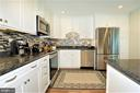 brand new kitchen with granite and backsplash - 2305 ROSEDOWN DR, RESTON